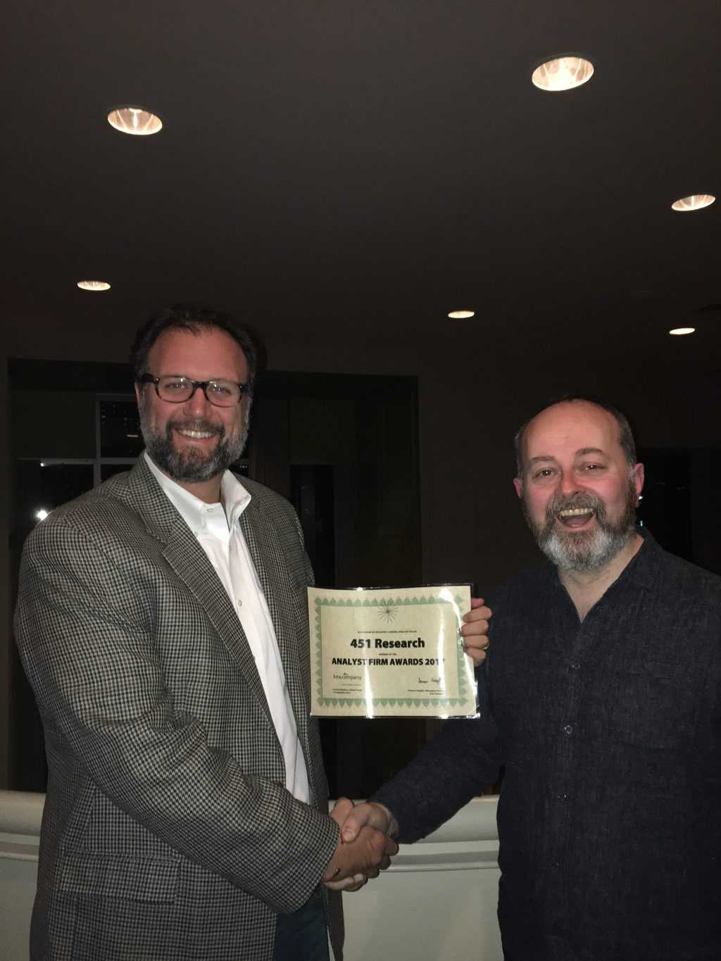 James Stanton accepts 451 Research's Analyst Firm Award from Duncan Chapple